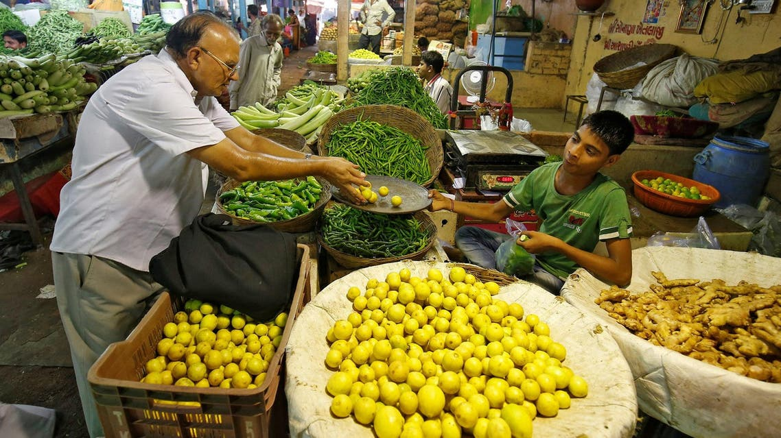 A man buys lemons at a market in Ahmedabad, India, September 12, 2017. (Reuters)