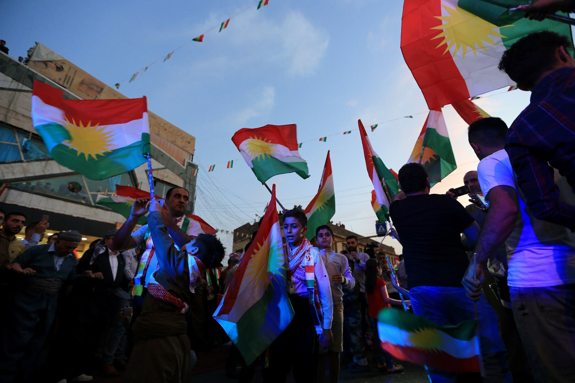 Kurds celebrate to show their support for the independence referendum in Duhok, Iraq, September 26, 2017. (Reuters)