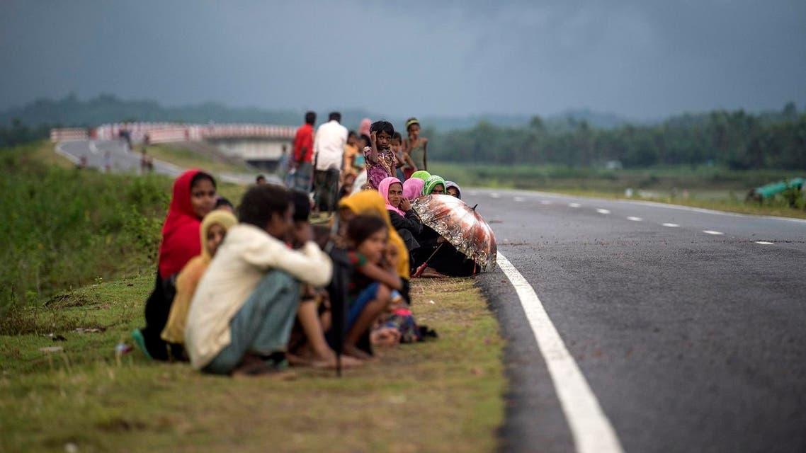 Rohingya Muslim refugees wait on a road in Bangladesh's Ukhia district on September 28, 2017. (AFP)