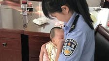 Chinese policewoman breastfeeds suspect's hungry baby