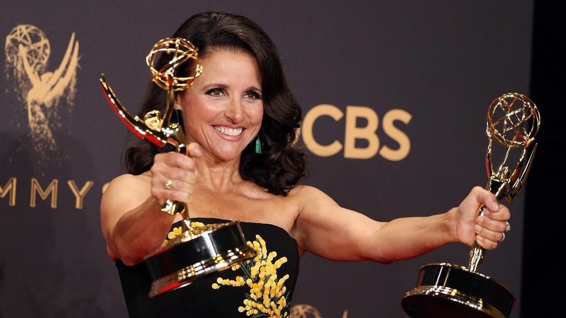 Julia Louis-Dreyfus holds her Emmys for Outstanding Lead Actress in a Comedy Series and Outstanding Comedy Series for Veep. Reuters