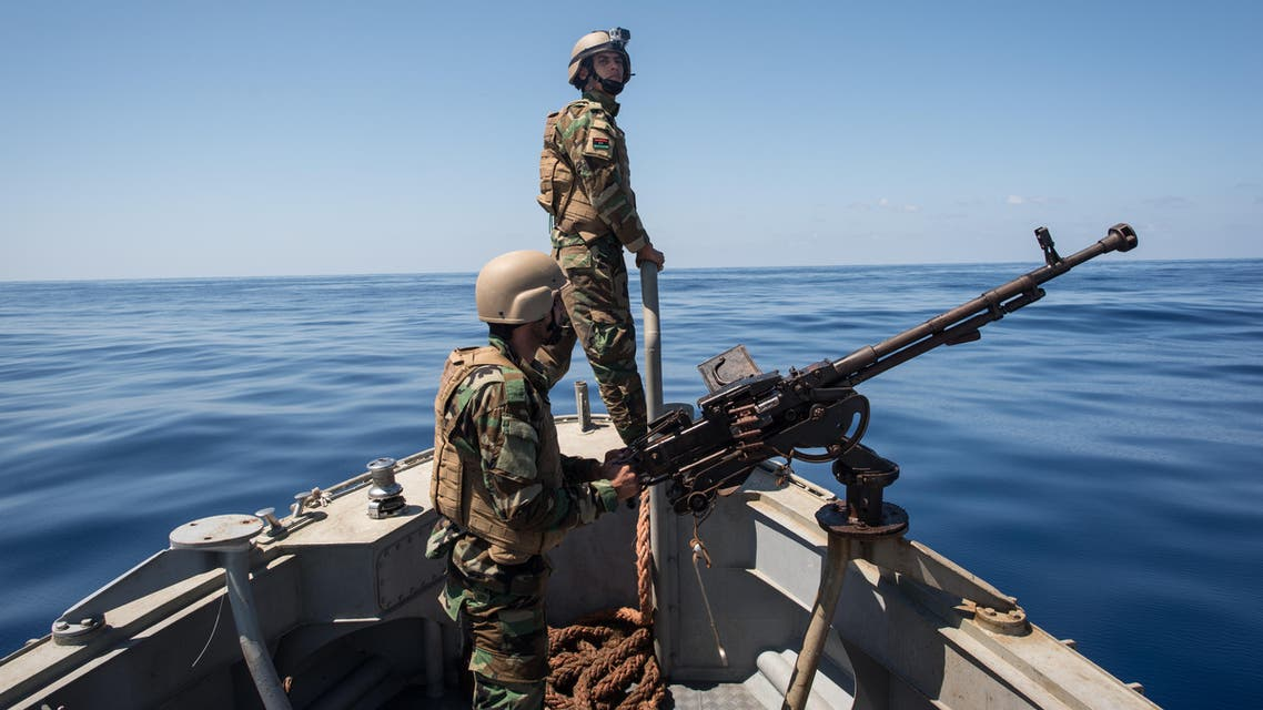 Libyan coastguards stand on an armoured boat as they patrol the area at sea between Sabratha and Zawiyah on July 28, 2017.  TAHA JAWASHI / AFP