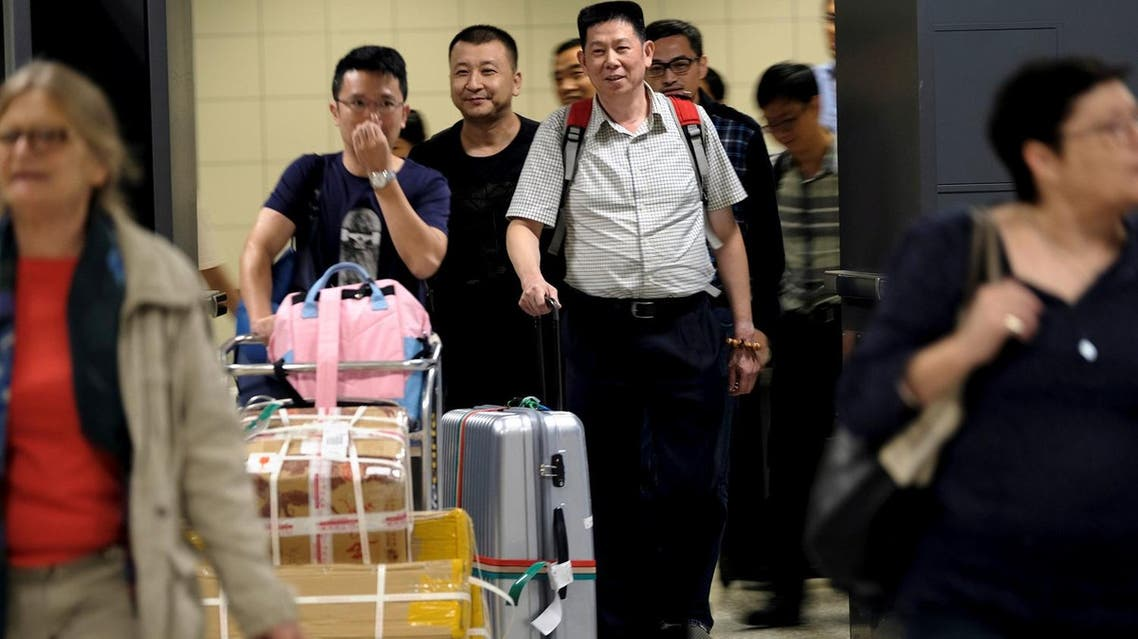 International passengers exit the transit area after clearing immigration and customs on arrival at Dulles International Airport, Virginia, US, on September 24, 2017. (Reuters)