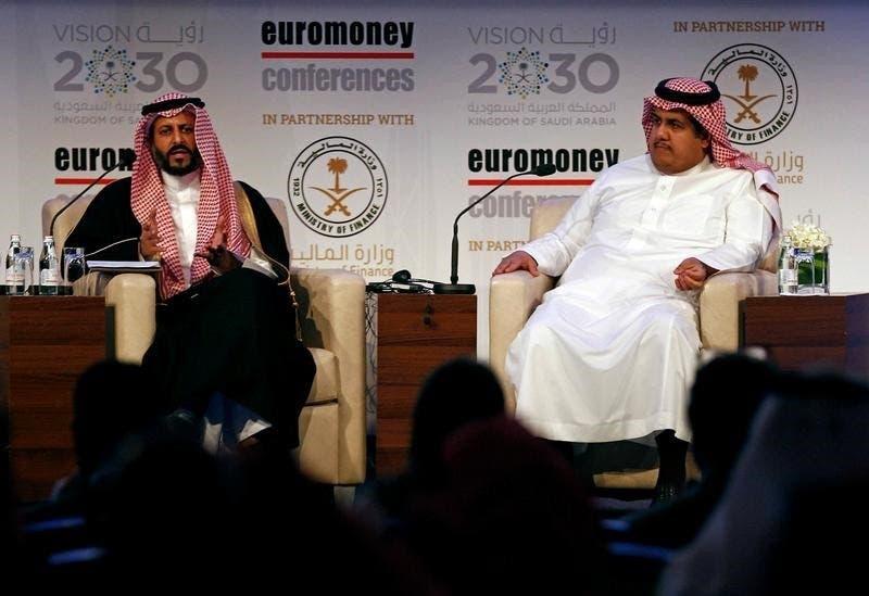 خالد الحصان المدير التنفيذي للسوق، ومحمد القويز رئيس هيئة السوق المالية بالسعودية