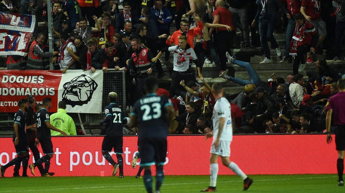 LOSC's supporters react as their tribune collapse following the goal by LOSC French defender Fode Ballo-Toure during the French L1 football match between Amiens and Lille LOSC on September 30, 2017 at the Licorne stadium in Amiens. Several Lille supporters were hurt in Amiens when a stadium barrier collapsed in the away section as the visiting fans celebrated the opening goal of the match. The Ligue 1 fixture was interrupted in the 16th minute after LOSC French defender Fode Ballo-Toure's goal sparked celebrations that caused a fence separating the fans from the pitch to crumble under their weight. (AFP)