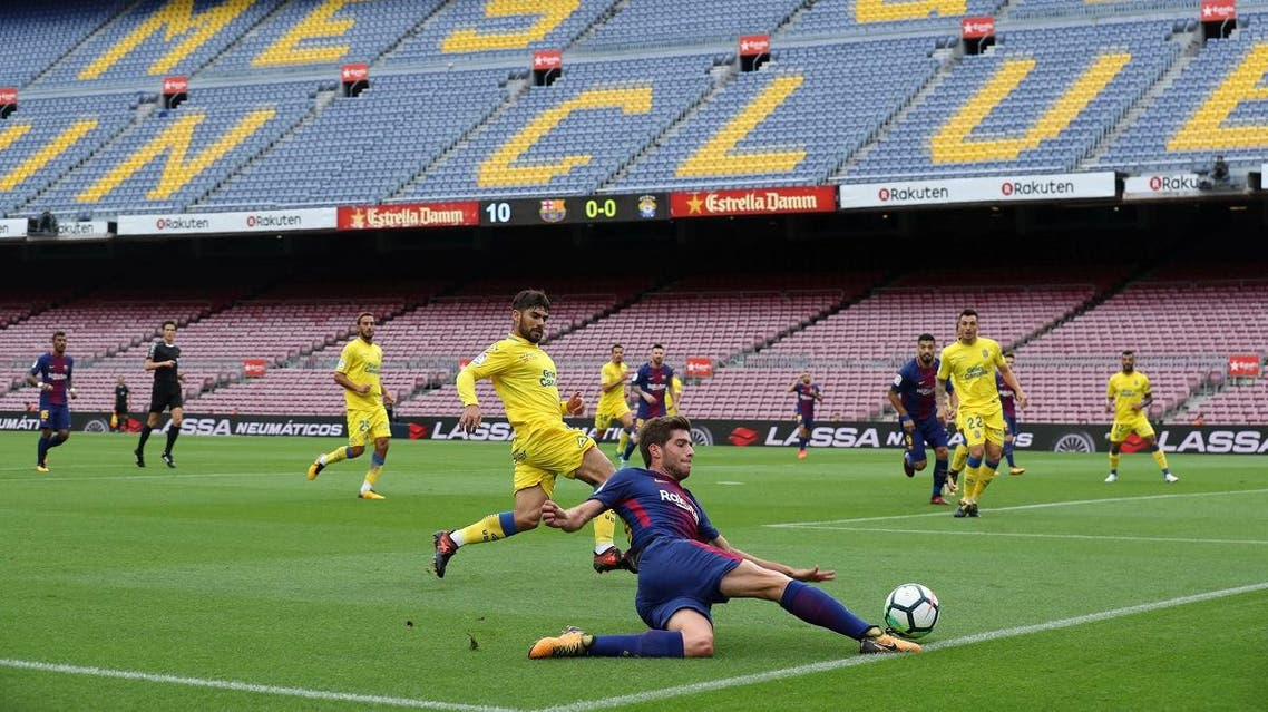 General view of Barcelona's Sergi Roberto in action infront of an empty stadium as the game is played behind closed doors. (Reuters)