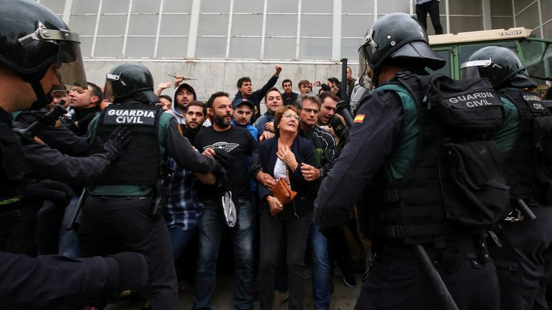People confront Spanish Civil Guard officers outside a polling station for the banned independence referendum in Sant Julia de Ramis. (Reuters)