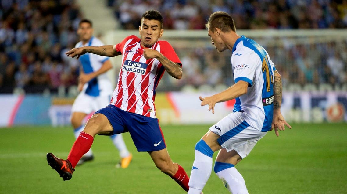 Atletico Madrid's forward from Argentina Angel Correa (L) vies with Leganes' defender from Spain Raul Garcia Carnero (R) during the Spanish league football match Club Deportivo Leganes SAD vs Club Atletico de Madrid at the Estadio Municipal Butarque in Madrid on September 30, 2017. (AFP)