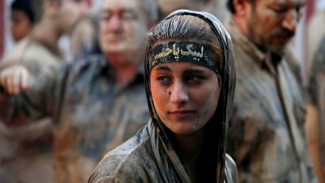 An Iranian woman after rubbing mud on her body during the 'Kharrah Mali' (Mud Rubbing) ritual to mark the Ashura in Khorramabad on October 1, 2017. (AFP)
