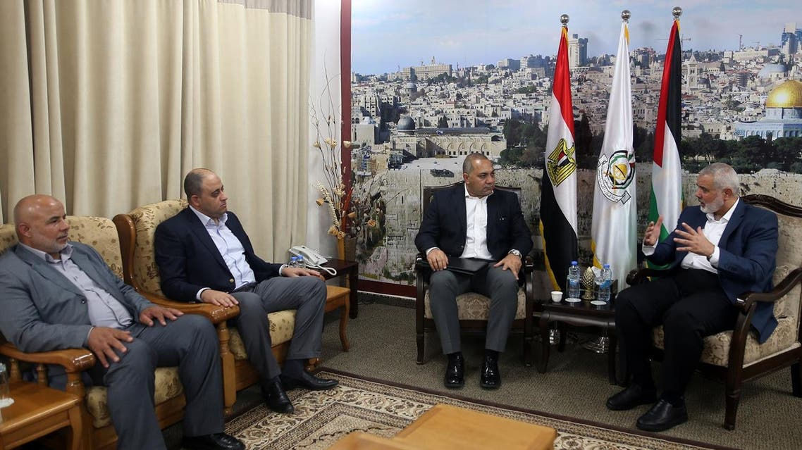 Senior Hamas official Ismail Haniyeh (R) meets members of the Egyptian Delegation at his office in Gaza City on October 1, 2017. (AFP)