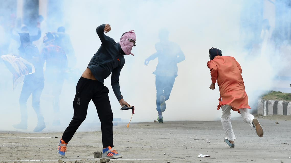 A Kashmiri youth throws a stone during clashes between protesters and Indian government forces in downtown Srinagar on September 2, 2017. afp