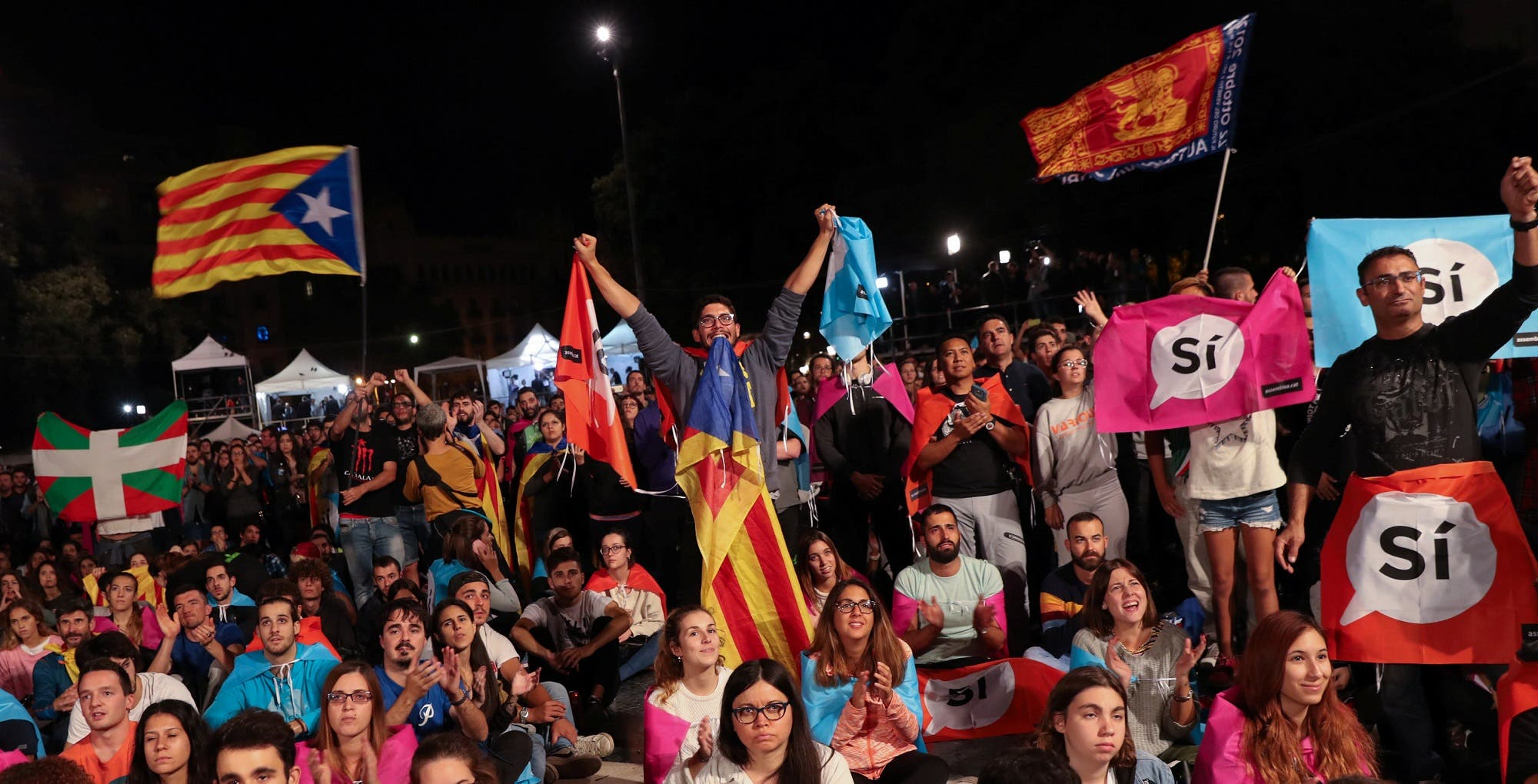 People react as they gather at Plaza Catalunya after voting ended for the banned independence referendum, in Barcelona, Spain, October 1, 2017. (Reuters)