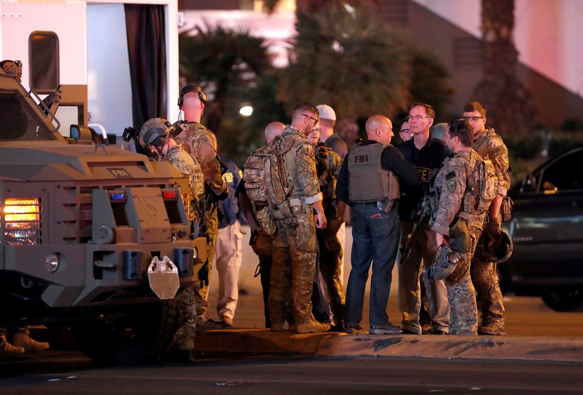 FBI agents confer in front of the Tropicana hotel-casino on October 2, 2017, after a mass shooting during a music festival on the Las Vegas Strip in Las Vegas. (Reuters)