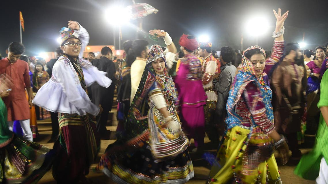 This September 28, 2017 picture shows Indian folk dancers performing during the Navratri festival in Gandhinagar, near Ahmedabad. (AFP)