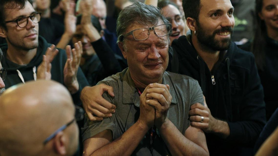 A member of the Catalan National Assembly (ANC) cries at the end of the voting day at the 'Espai Jove La Fontana' (La Fontana youth center) polling station, on October 1, 2017 in Barcelona. (AFP)