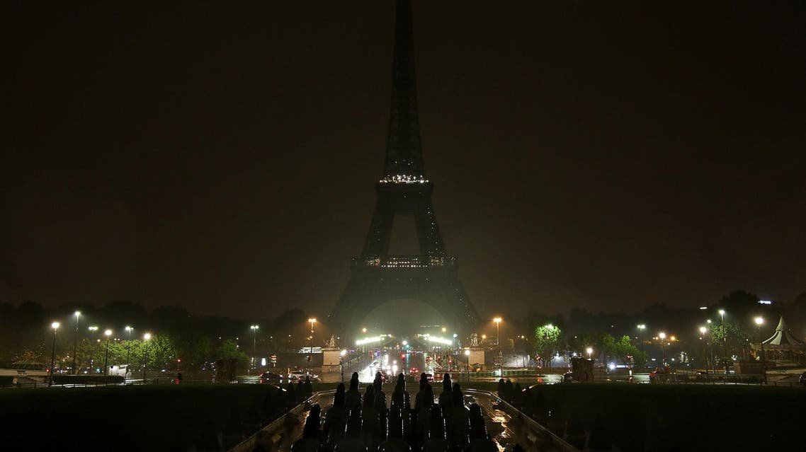 The lights of the Eiffel Tower are switched off on October 2, 2017 in tribute to the victims of the attacks in Las Vegas and Marseille. (AFP)