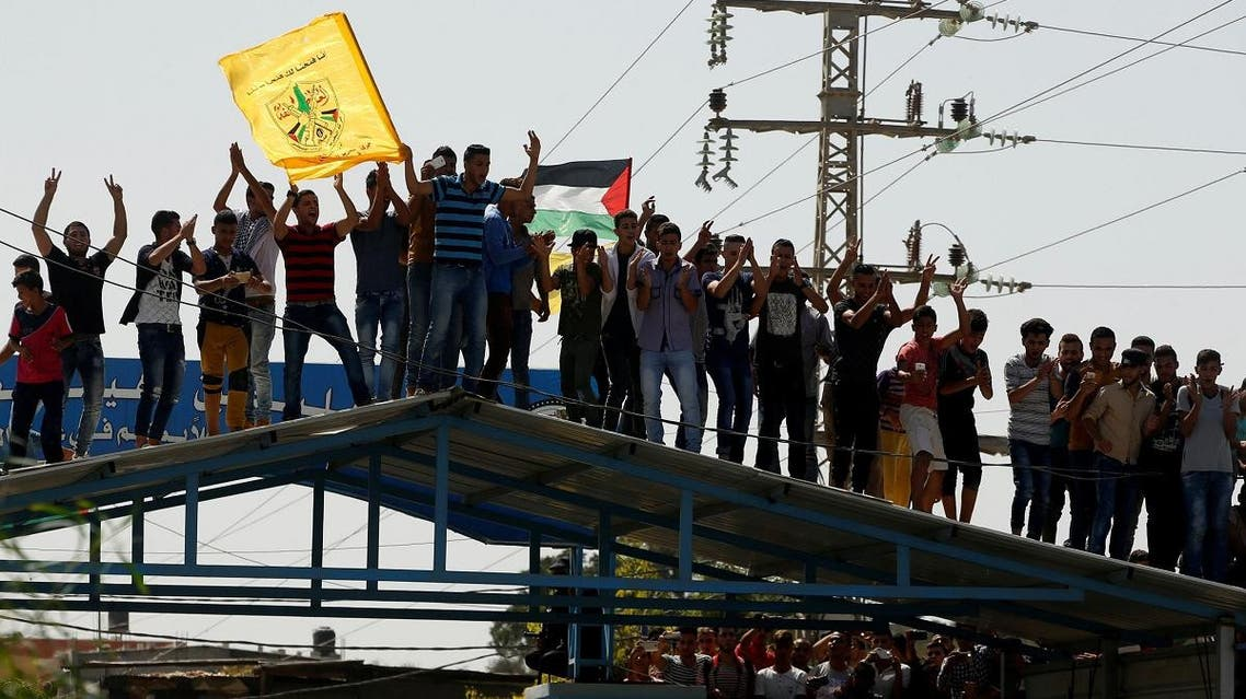 People celebrate as Palestinian Prime Minister Rami Hamdallah arrives to take control of Gaza from the Islamist Hamas group, in the northern Gaza Strip. (Reuters)