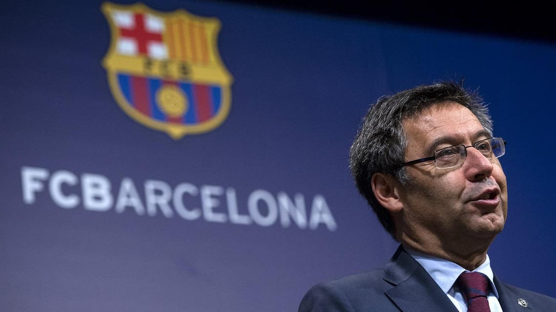 FC Barcelona's president Josep Maria Bartomeu speaks during a press conference at the Camp Nou stadium in Barcelona on October 2, 2017. Barcelona president Josep Maria Bartomeu confirmed today two of the club's board members resigned in the wake of his decision to play a match behind closed doors after a violent crackdown by police of an independence referendum for Catalonia yesterday. (AFP)