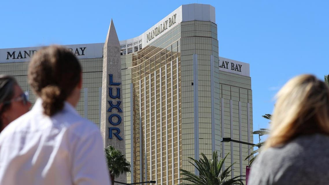 People stand behind police barrier tape outside the Luxor hotel Obelisk and the Mandalay Bay Resort and Casino, following a mass shooting at the Route 91 Festival in Las Vegas, Nevada, US, October 2, 2017. (Reuters)