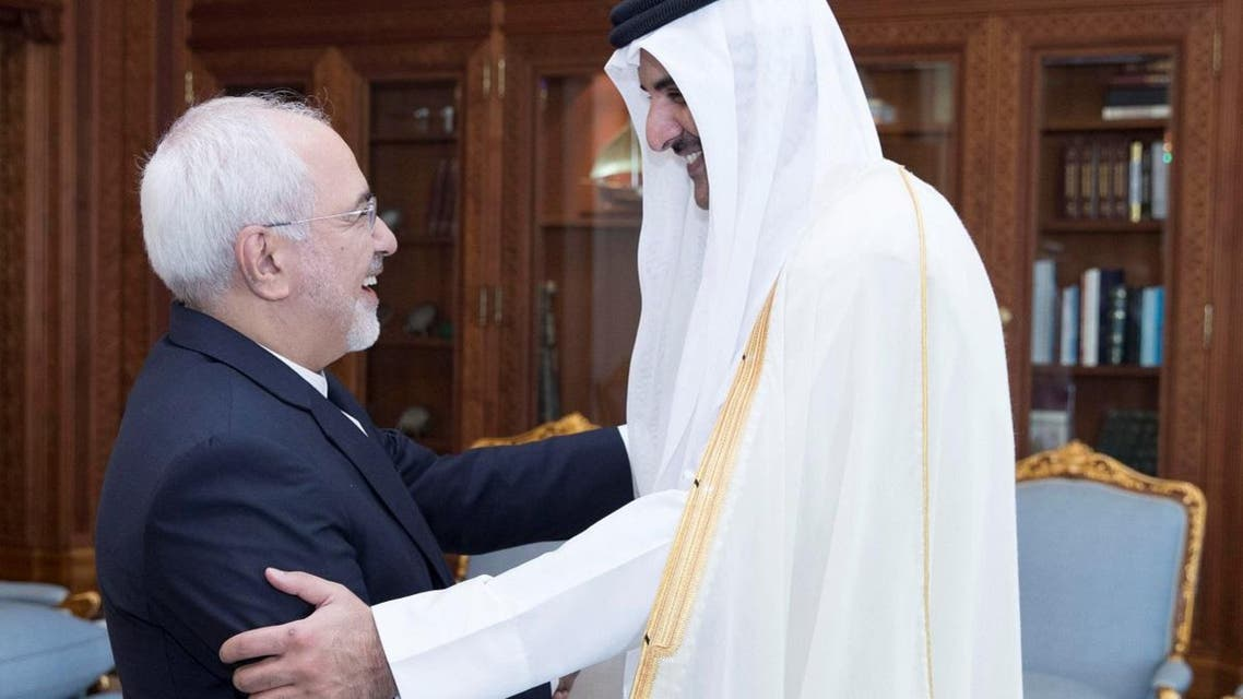 Emir of Qatar Sheikh Tamim bin Hamad al-Thani shakes hands with Iran's Foreign Minister Mohammad Javad Zarif during their meeting in Doha. (Reuters)