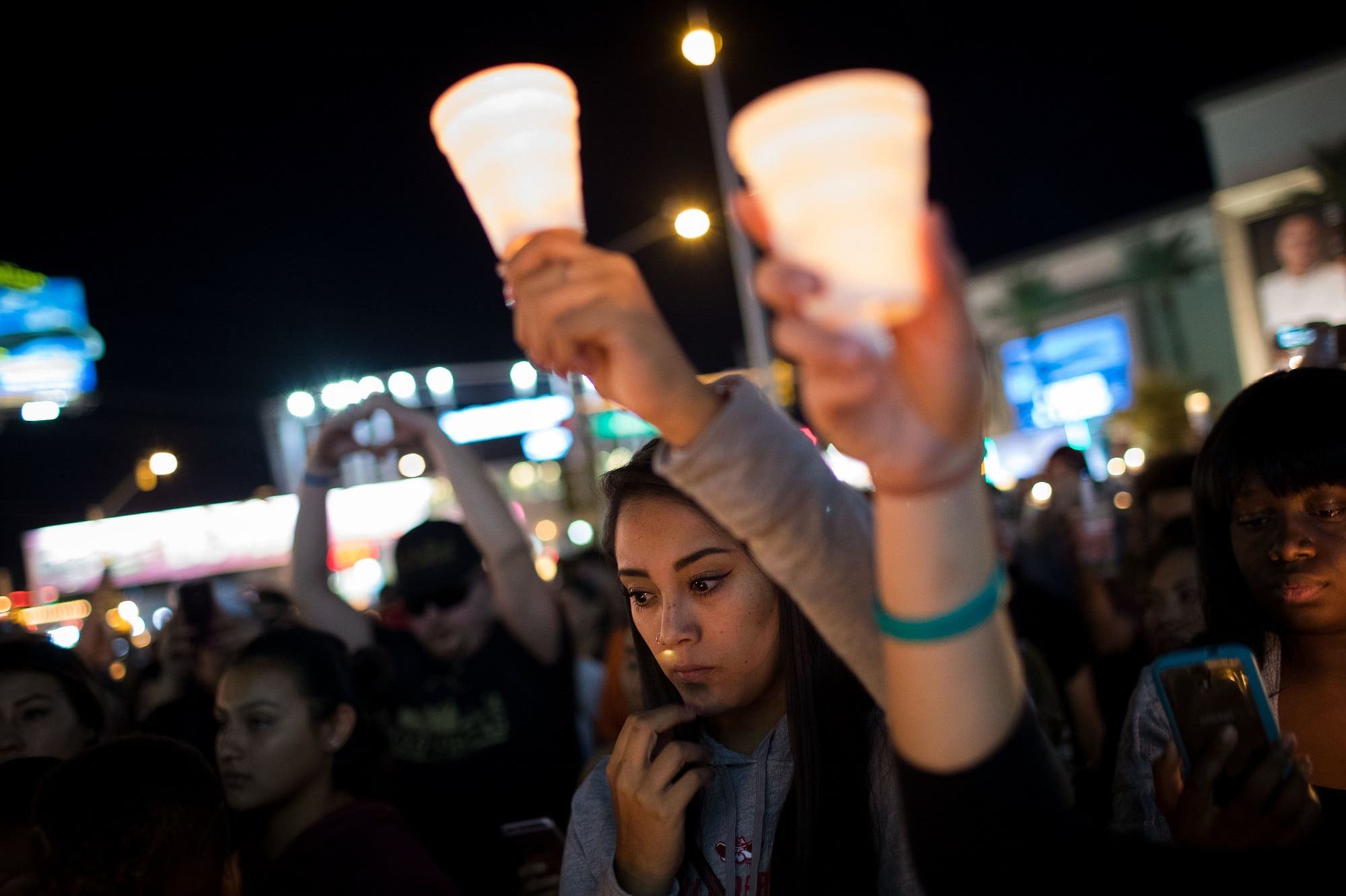 Mourners attend a candlelight vigil at the corner of Sahara Avenue and Las Vegas Boulevard for the victims of Sunday night's mass shooting, on October 2, 2017 in Las Vegas, Nevada. (AFP)
