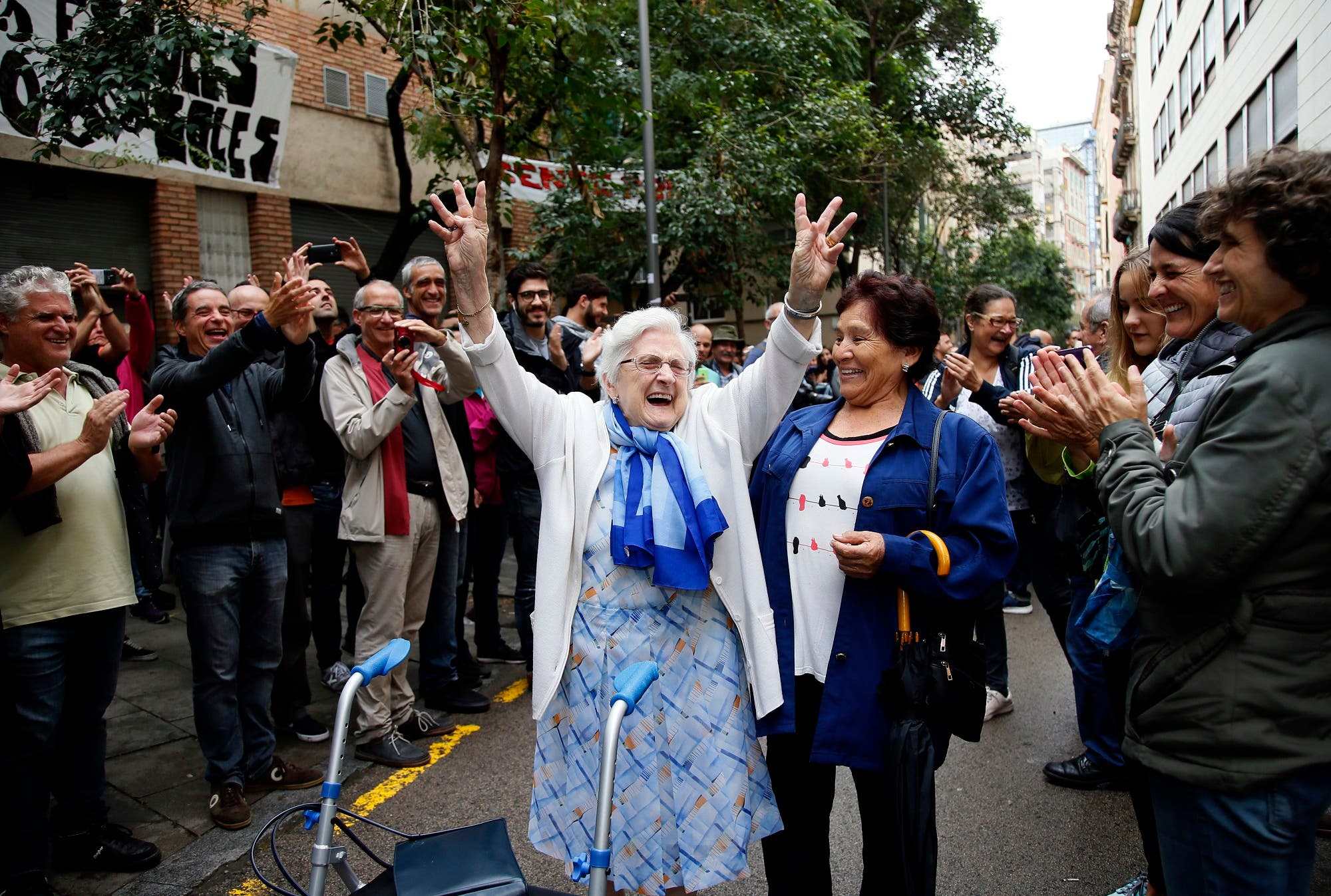 In this Oct. 1, 2017 photo, an elderly celebrates after voting at a school assigned to be a polling station by the Catalan government at the Gracia neighborhood in Barcelona, Spain. (AP)