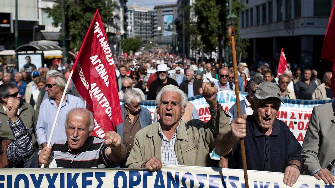 Protesting pensioners chant anti-austerity slogans as they demonstrate in central Athens, Tuesday, Oct. 3, 2017. Pension associations launched a 10-day nationwide protest campaign, starting in Athens, against further bailout-related pension payment cuts planned over the next two years. (AP Photo/Petros Giannakouris)