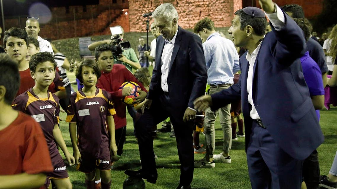 Italian soccer coach Carlo Ancelotti stand with Muslim, Christian and Jewish youth as part of the Assist for Peace, a coexistence group, in Jerusalem Monday, Oct. 2, 2017. Bayern Munich fired Ancelotti as coach on Thursday after the German team's heaviest Champions League group-stage defeat. (AP)