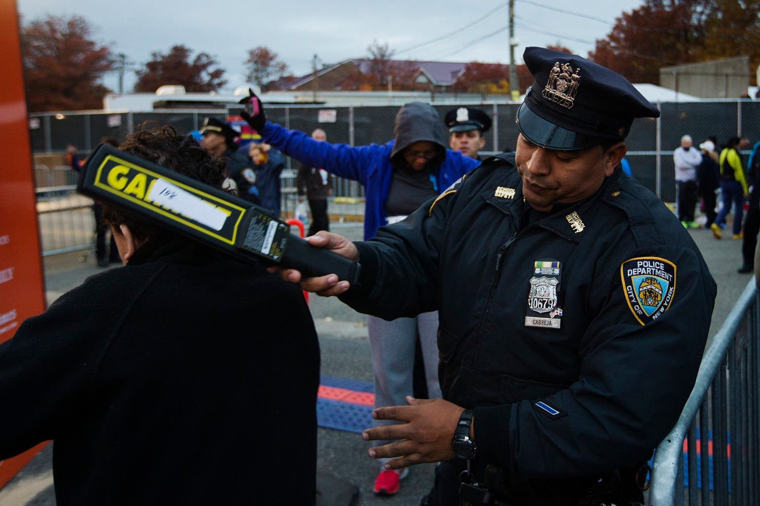 New York Police Department officers perform a security sweep on runners arriving to take part in the New York City Marathon. (Reuters)