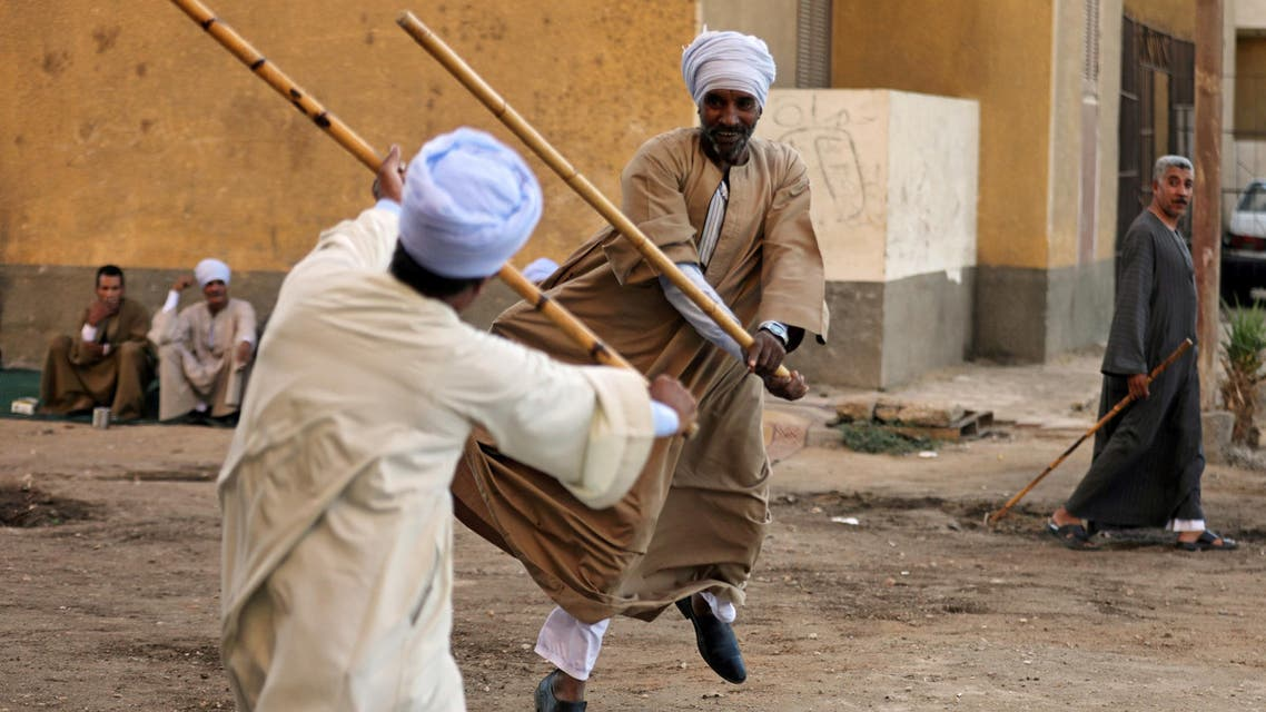 Zayed Abd El Naiem and Masry Abd El Fatha dance with their 'El Nabout' canes as they perform Tahteeb, an ancient form of martial arts and dance, in Sohag, Egypt, September 19, 2017. (reuters)