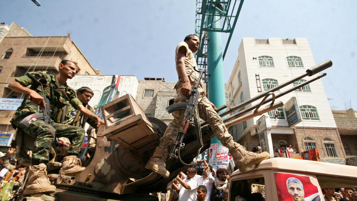 Pro-government troops ride on the back of a military truck as they parade to mark the 55th anniversary of the September 1962 revolution in the war-torn southwestern city of Taiz, Yemen September 26, 2017. (Reuters)