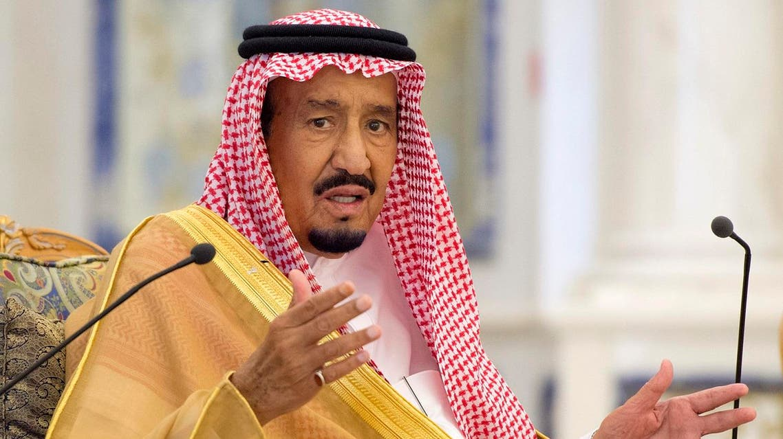 A handout picture provided by the Saudi Royal Palace on September 20, 2017 shows King Salman bin Abdulaziz Al Saud speaking during a ceremony welcoming the Saudi national football team at the Royal Palace in Jeddah. (AFP)