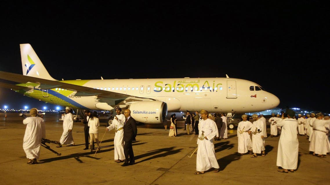 Omanis take photos on the tarmac during the unveiling of SalamAir at the Muscat International Airport on January 29, 2017. (AFP)