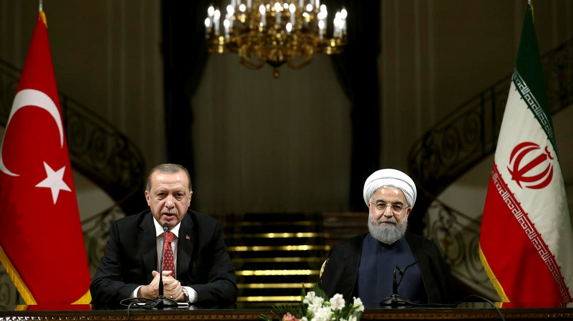 Turkish President Recep Tayyip Erdogan, left, speaks with media during a joint press conference with Iranian President Hassan Rouhani after their meeting at the Saadabad Palace in Tehran, Iran, Wednesday, Oct. 4, 2017. AP