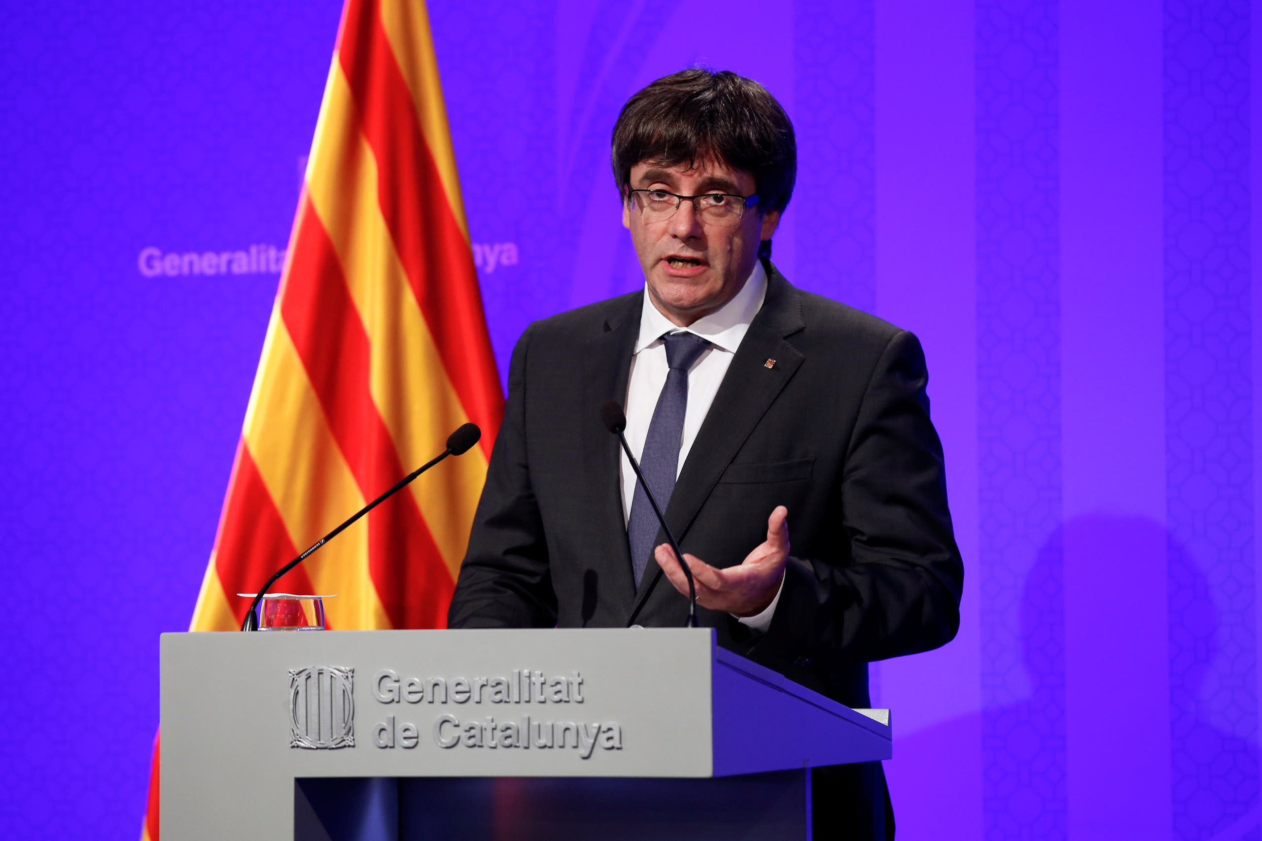 Catalan President Carles Puigdemont speaks during a news conference at Generalitat Palace in Barcelona, Spain October 2, 2017. REUTERS/Albert Gea