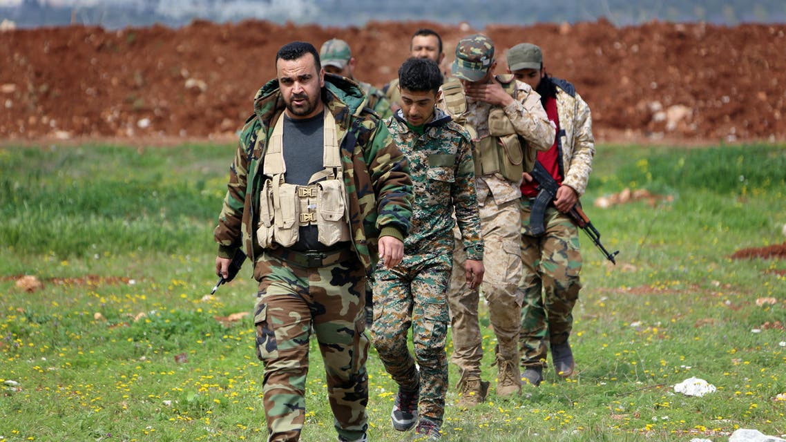 Members of the Syrian government forces march near the town of Qumhanah in the countryside of the central province of Hama, on April 1, 2017. (AFP)