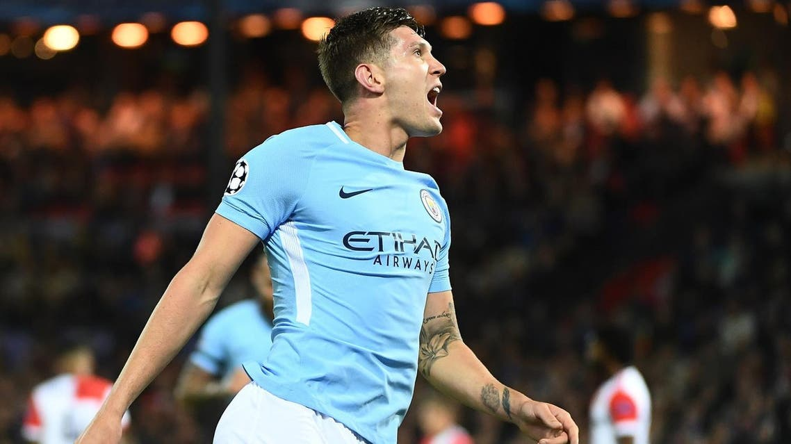 Manchester City's English defender John Stones celebrates after scoring his second goal during the UEFA Champions League Group F football match between Feyenoord Rotterdam and Manchester City at the Feyenoord Stadium in Rotterdam, on September 13, 2017. Reuters
