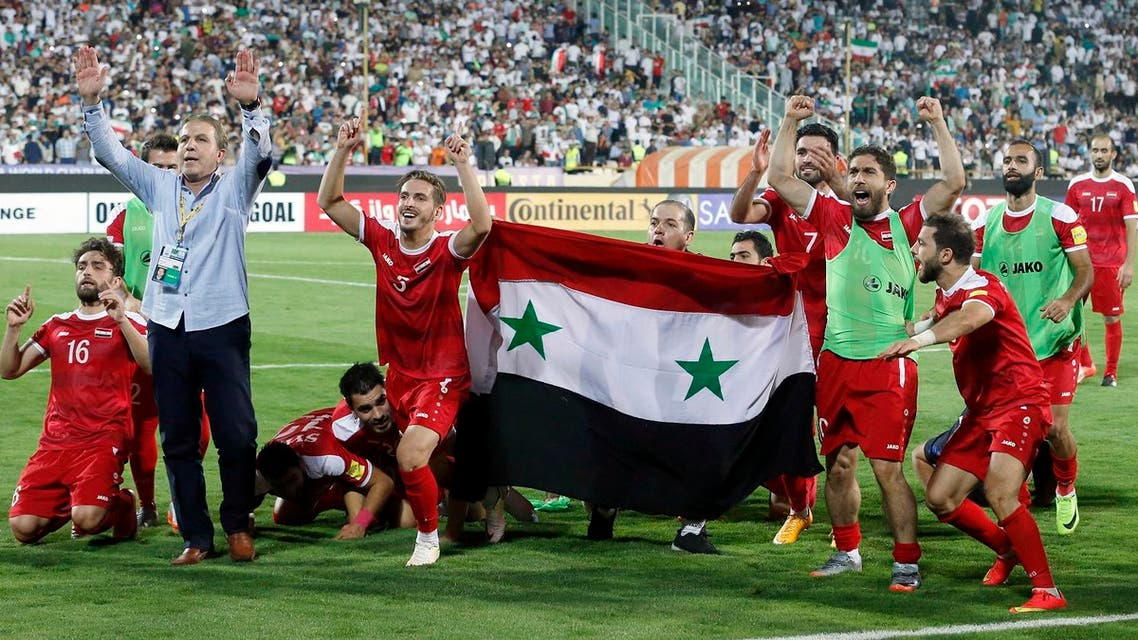 Syria's players celebrate at the end of their FIFA World Cup 2018 qualification football match against Iran at the Azadi Stadium in Tehran on September 5, 2017. (AFP)
