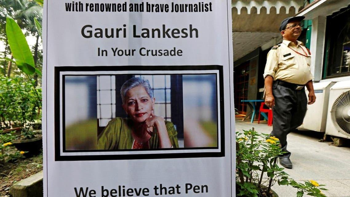 A security guard walks past a placard installed at the Press Club of Kolkata in solidarity with Gauri Lankesh in Kolkata. (Reuters)