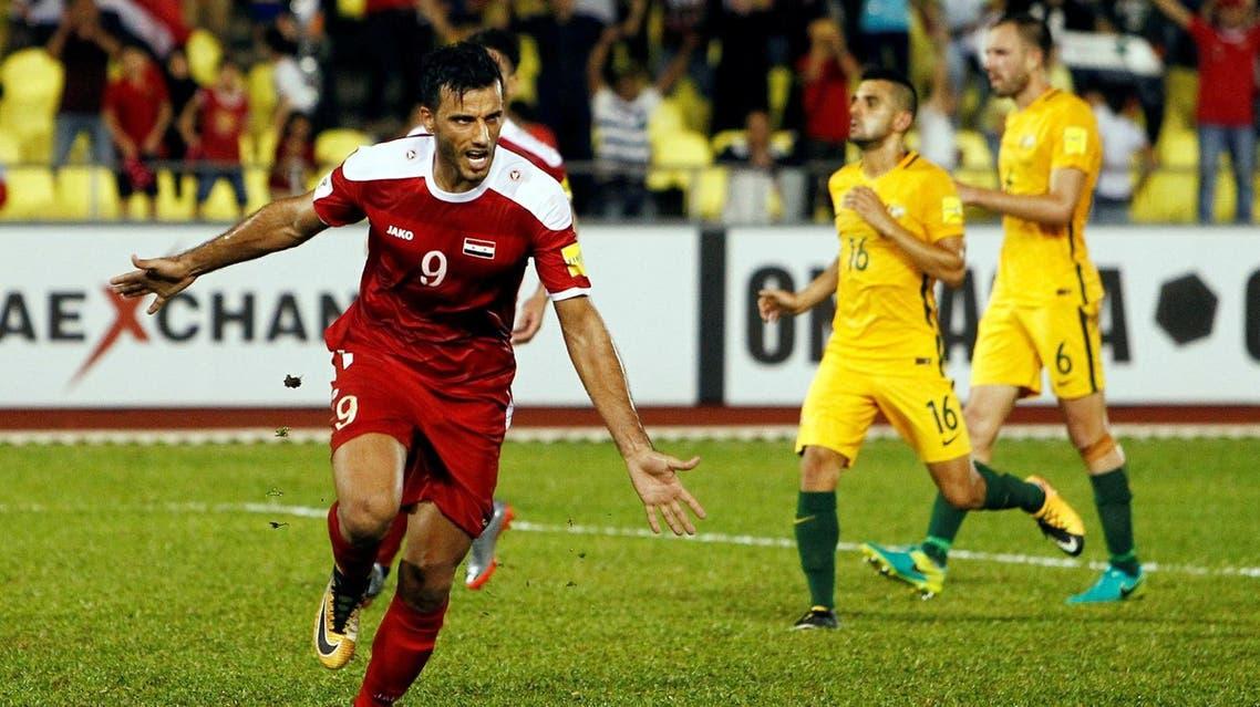 Football Soccer - Syria v Australia - 2018 World Cup Qualifying Asia Zone Playoffs - Hang Jebat Stadium, Melaka, Malaysia - October 5, 2017. Syria's Omar Al Soma celebrates after scoring with a penalty kick. REUTERS/Lai Seng Sin