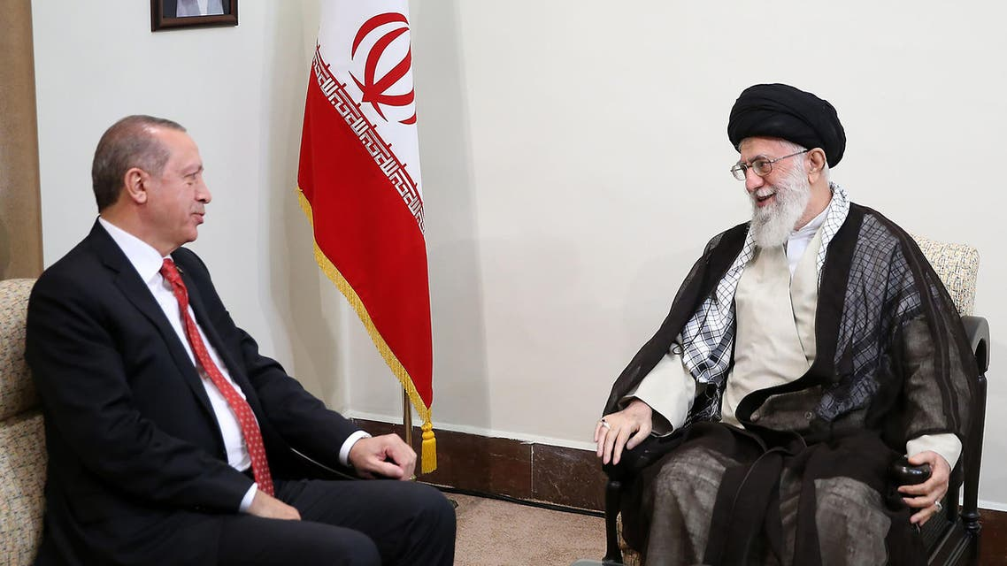 A handout photo provided by the office of Iran's supreme leader Ayatollah Ali Khamenei shows him (R) meeting with Turkish President Recep Tayyip Erdogan in Tehran on October 4, 2017.  HO / Iranian Supreme Leader's Website / AFP
