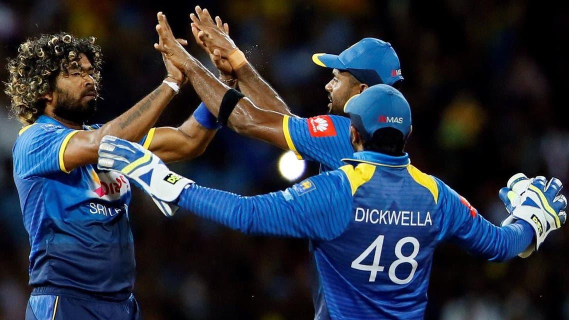 Sri Lanka's Lasith Malinga celebrates with Seekkuge Prasanna and Niroshan Dickwella after taking the wicket of India's Rohit Sharma. (File photo: Reuters)