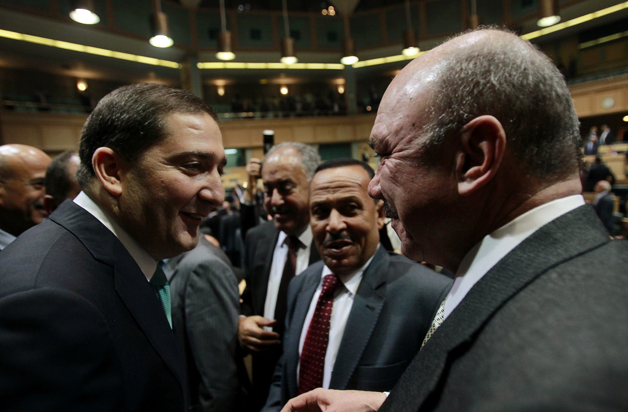 Samir al-Rifai accepts congratulations from President of the House of Representatives Faisal Al Fayez (R) after winning the vote of confidence in the House of Representatives in Amman December 23, 2010. (Reuters)