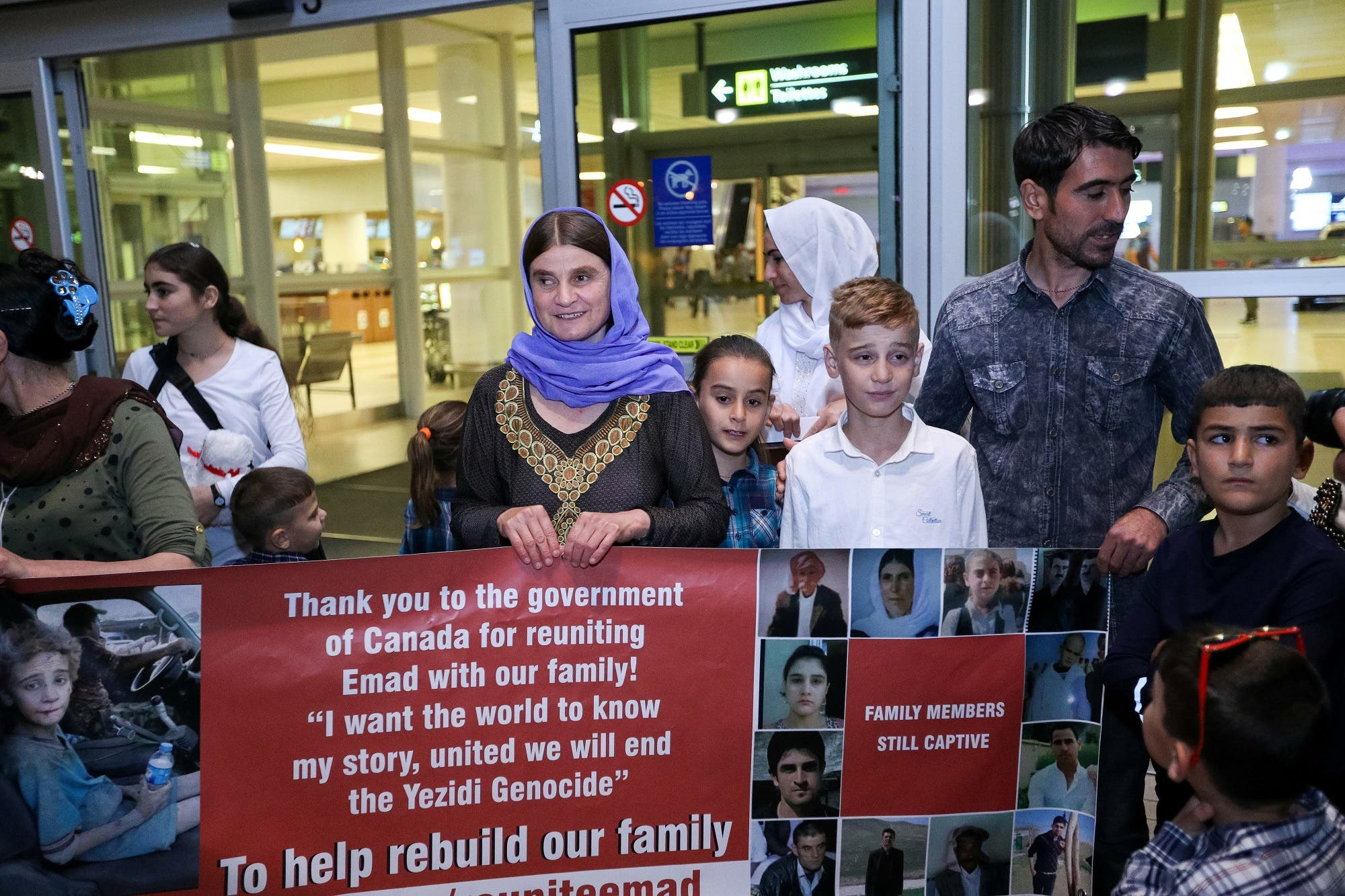 Imad Mishko Tammo, 12-year-old Yazidi boy, who was separated from his family after being captured by ISIS in Iraq, is reunited with his mother and siblings on arrival in Winnipeg, Manitoba, Canada, August 17, 2017. (Reuters)