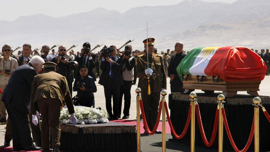 Iraqi President Fuad Massum (left) lays a wreath next to Iraqi ex-president Jalal Talabani's coffin during a ceremony at the airport in the Iraqi Kurdish city of Sulaimaniyah on October 6, 2017. (AFP)