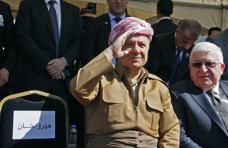 Iraqi Kurdish leader Massoud Barzani (left) sits next to Iraqi President Fuad Massum during a ceremony following the arrival of Iraqi ex-president Jalal Talabani's coffin. (AFP)