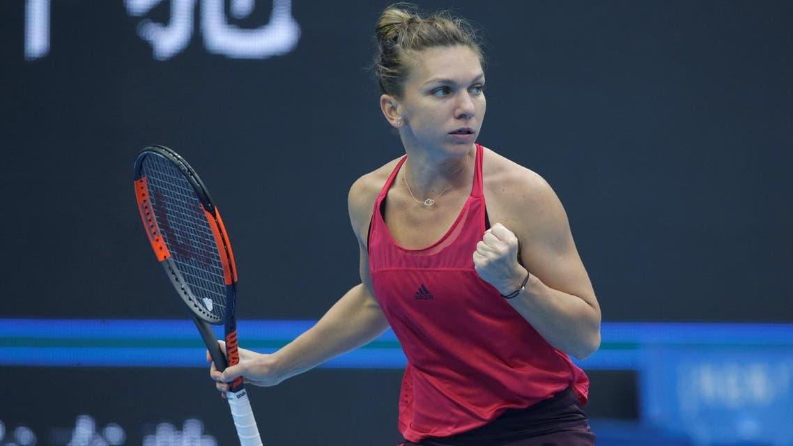 Simona Halep of Romania celebrates after winning a point against Jelena Ostapenko of Latvia. (Reuters)