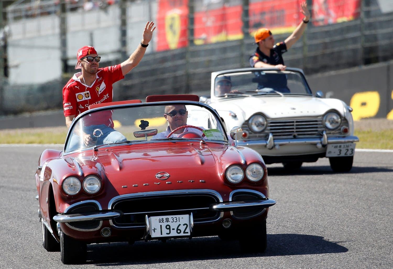 Ferrari's Sebastian Vettel of Germany attends a drivers' parade before the start of the Japanese Grand Prix race. (Reuters)