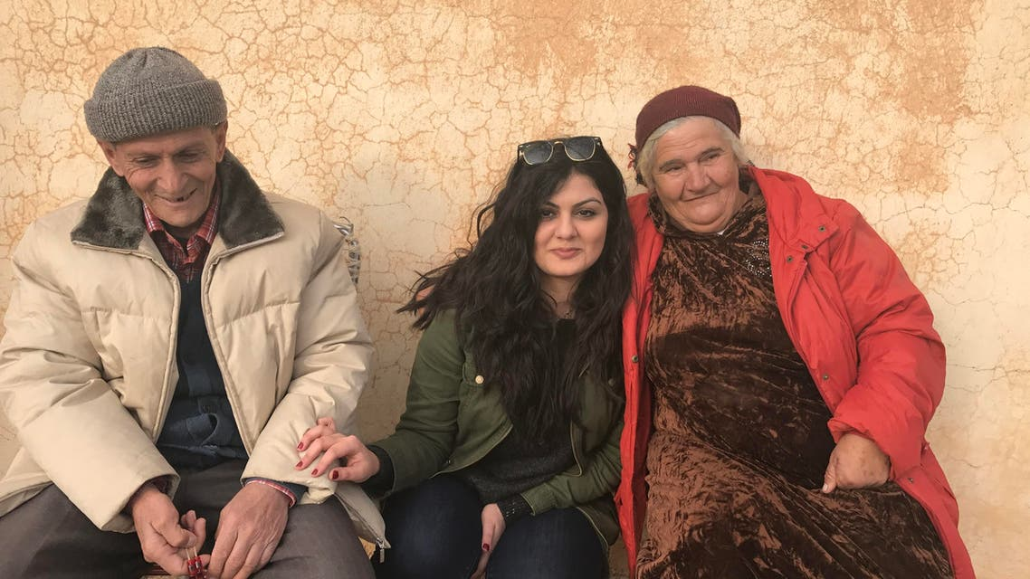 Reine Hanna (C) with an elderly couple in Dashqotani, near Alqosh, in Nineveh Plain. The couple reportedly told her that they are the only members of their respective families who refused to leave Iraq. (Picture supplied)