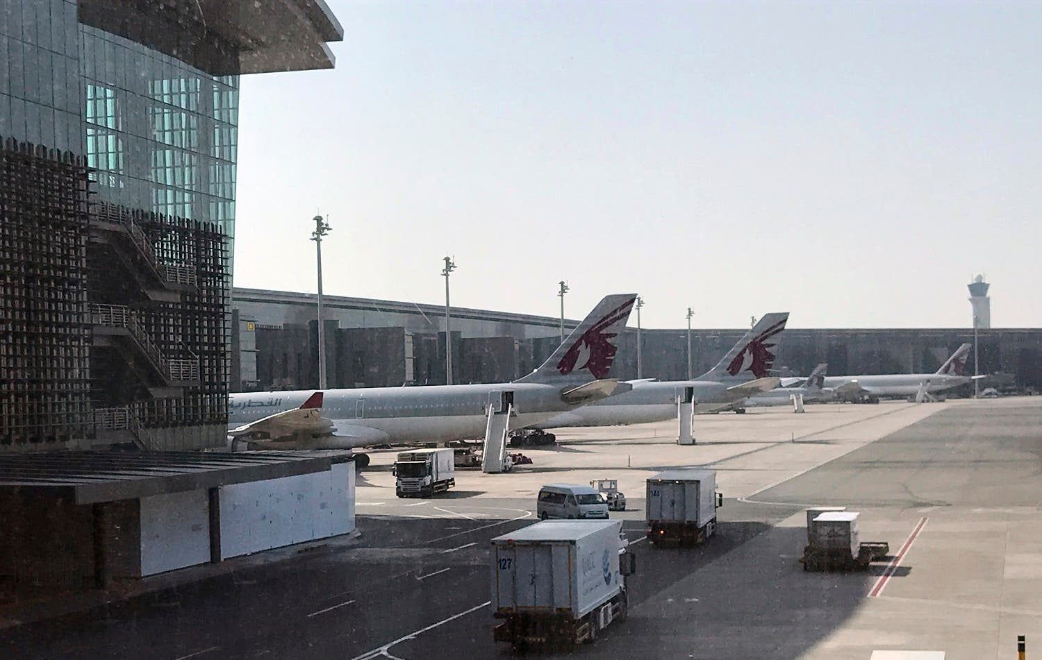Qatar Airways planes are seen parked at the Hamad International Airport in Doha. (AP)